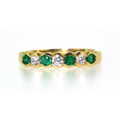 SEVEN STONE EMERALD AND DIAMOND HALF ETERNITY RING