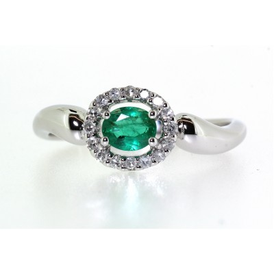 OVAL HALO EMERALD AND DIAMOND RING