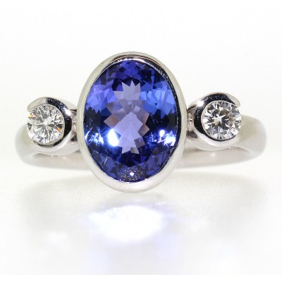 OVAL CUT TANZANITE AND DIAMOND RING