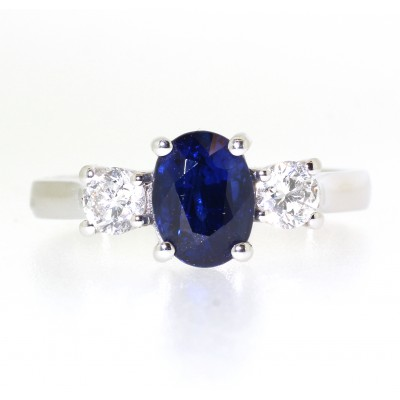 OVAL CUT SAPPHIRE AND ROUND BRILLIANT CUT DIAMOND THREE STONE RING