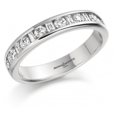 ROUND BRILLIANT AND BAGUETTE CUT CHANNEL SET DIAMOND WEDDING RING